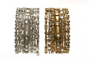 A 7 piece bangle set with clear crystal and alternating designs. Available in antique gold or silver finish. A bargain for $37.50. Also by Amrita Singh Jewelry